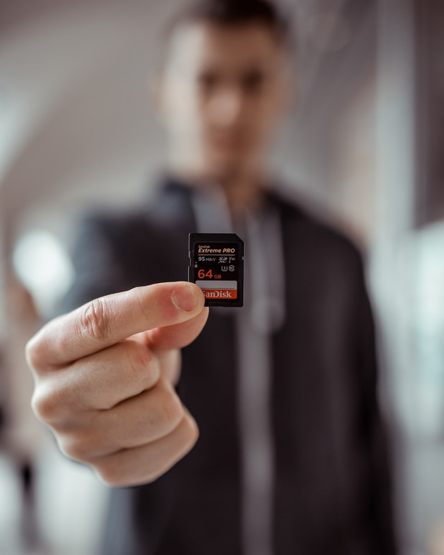 Right SD card person holding